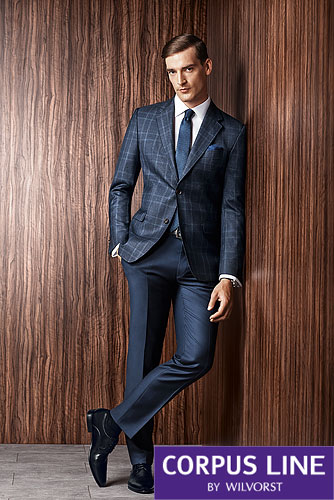Everything we make can be done in single piece,two piece or three piece combinations Image shows Vitale Barberis Check jacket with navy slacks