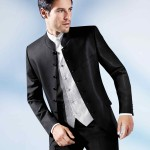 Black Stand Up Collar Suit In A Subtle Pattern With Restrained Shine