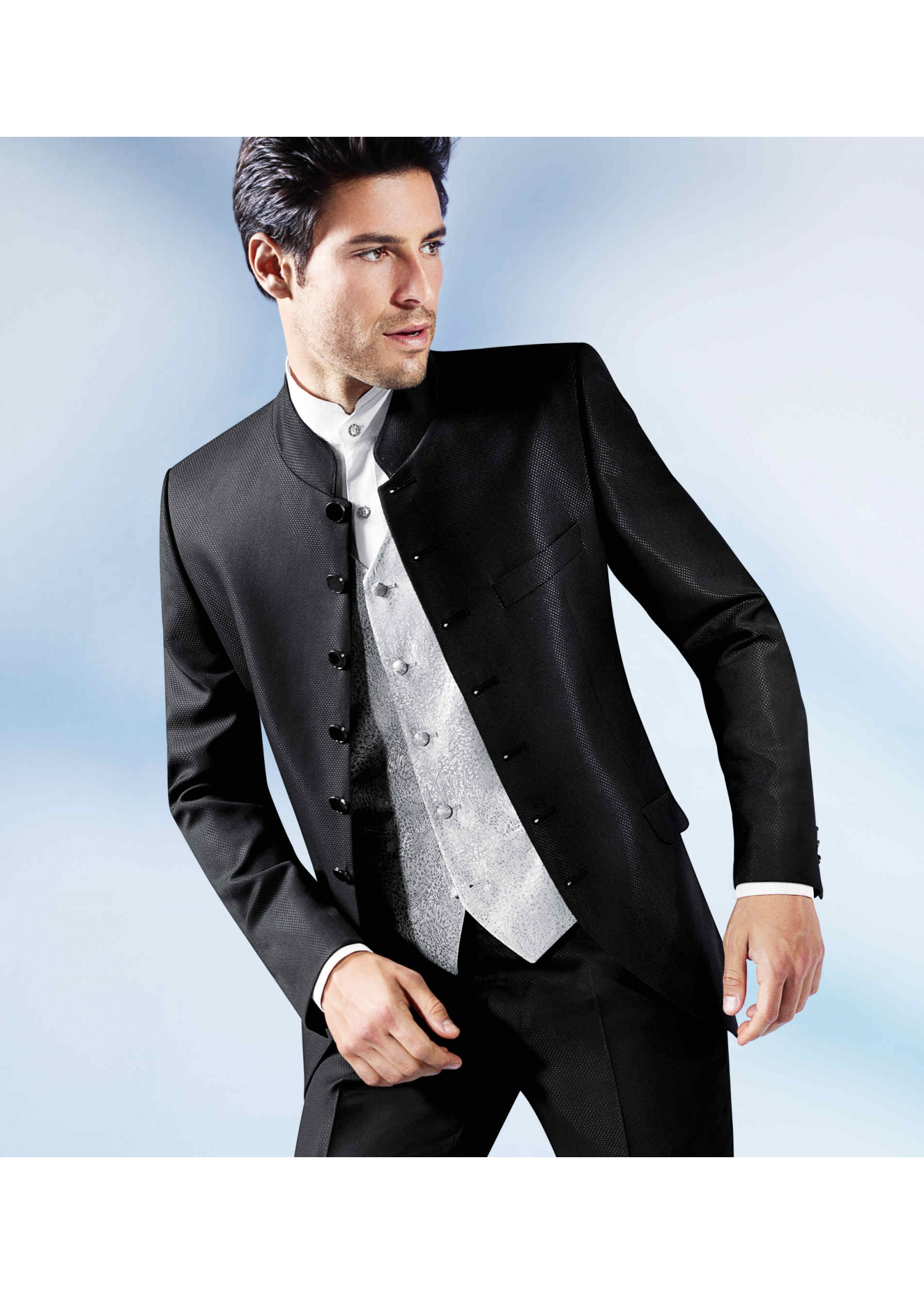black stand up collar suit in a subtle pattern with