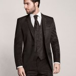 Single-breasted, one-button jacket impresses with a minimal diamond pattern