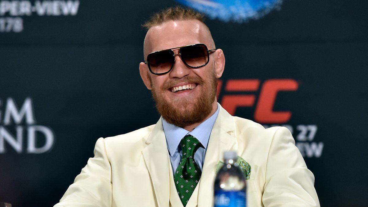 conor mcgregor white suit